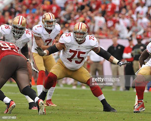 Guard Alex Boone of the San Francisco 49ers sets to block against the Tampa Bay Buccaneers December 15 2013 at Raymond James Stadium in Tampa Florida