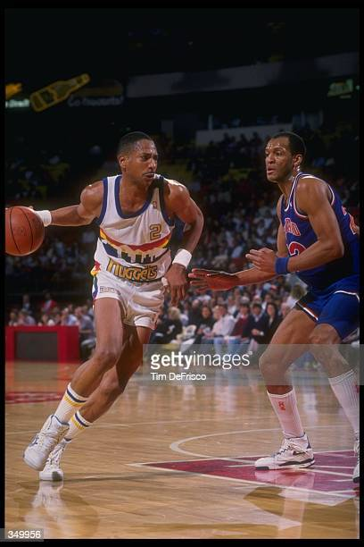 Guard Alex English of the Denver Nuggets moves the ball during a game versus the Cleveland Cavaliers at the McNichols Sports Arena in Denver,...