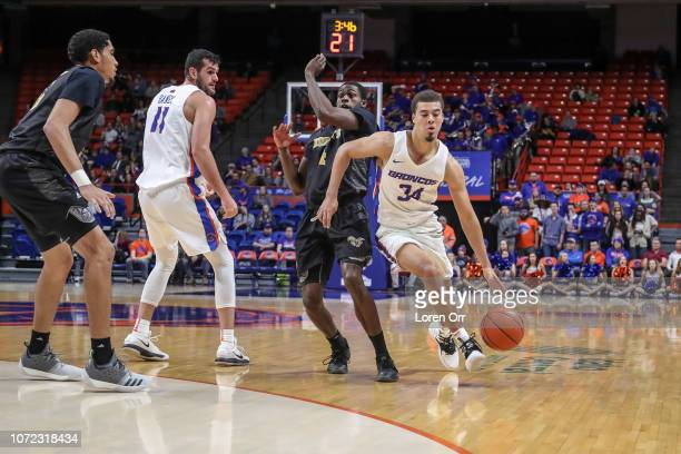Guard Alex Hobbs of the Boise State Broncos drives around the defense of guard Leon Daniels of the Alabama State Hornets during second half action on...