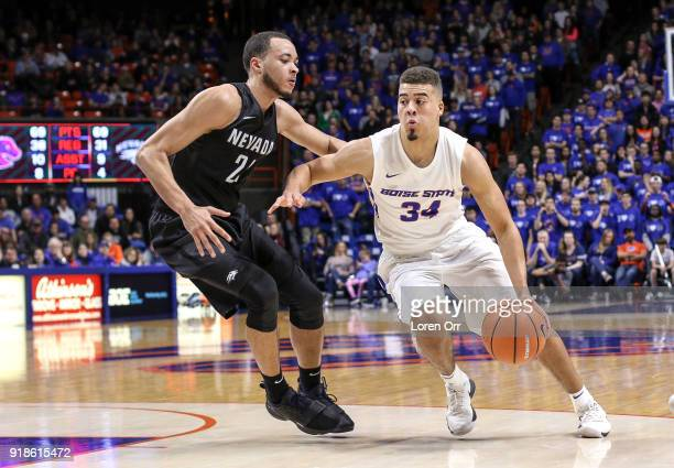 Guard Alex Hobbs of the Boise State Broncos drives towards the paint past guard Kendall Stephens of the Nevada Wolf Pack during second half action on...