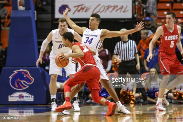Guard Alex Hobbs of the Boise State Broncos tries to pull in a charge call from guard Anthony Mathis of the New Mexico Lobos during second half...