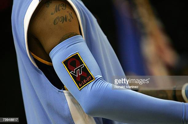 Guard Allen Iverson of the Denver Nuggets wears a Virginia Tech University patch on his armband in honor of those who were killed on April 16 before...