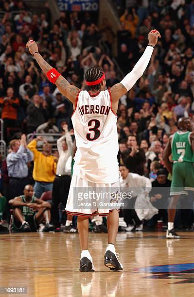 Guard Allen Iverson of the Philadelphia 76ers celebrates the victory over the Boston Celtics at the First Union Center on December 4 2002 in...