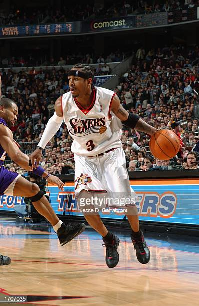 Guard Allen Iverson of the Philadelphia 76ers dribbles past guard Derek Fisher of the Los Angeles Lakers during the game at First Union Center on...