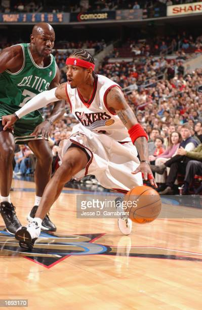 Guard Allen Iverson of the Philadelphia 76ers drives against guard Tony Delk of the Boston Celtics during the game at the First Union Center on...