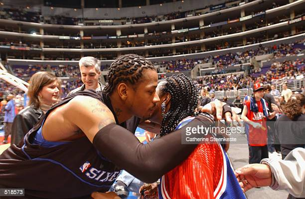 Guard Allen Iverson of the Philadelphia 76ers kisses his mother Anne before the NBA game against the Los Angeles Clippers at Staples Center in Los...