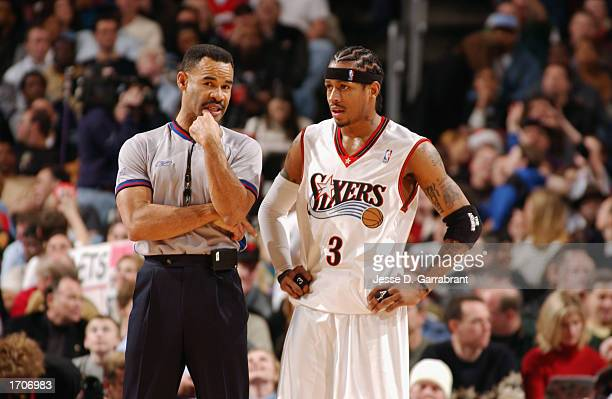Guard Allen Iverson of the Philadelphia 76ers listens to referee Dan Crawford during the game against the Los Angeles Lakers at First Union Center on...
