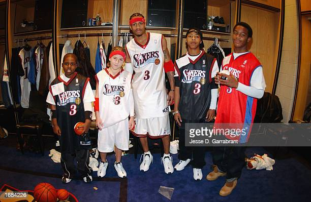 Guard Allen Iverson of the Philadelphia 76ers poses with four children who got to meet Allen and his teammates as part of the NBA Make a Wish...