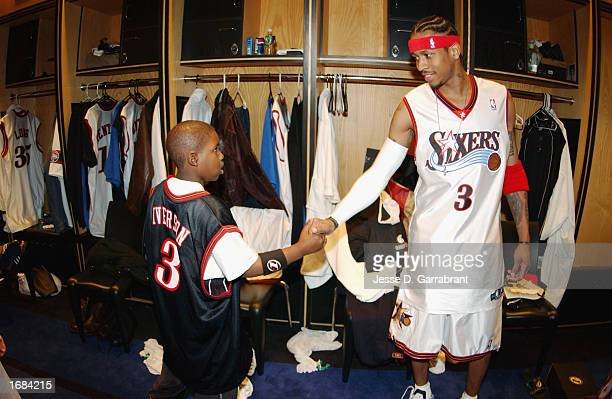 Guard Allen Iverson of the Philadelphia 76ers shakes hands with a child as part of the NBA Make a Wish Foundation held at First Union Center on...