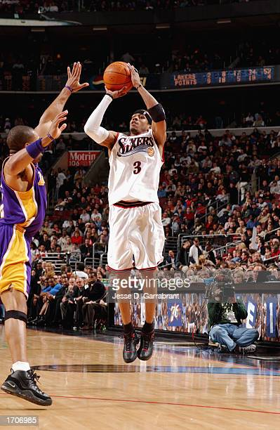 Guard Allen Iverson of the Philadelphia 76ers shoots a jump shot over guard Derek Fisher of the Los Angeles Lakers during the game at First Union...
