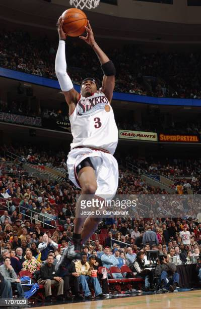Guard Allen Iverson of the Philadelphia 76ers shoots a layup against the Los Angeles Lakers during the game at First Union Center on December 20 2002...