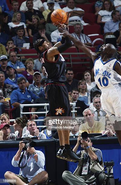 Guard Allen Iverson of the Philadelphia 76ers shoots the ball as guard Darrell Armstrong of the Orlando Magic goes up for the block during the game...