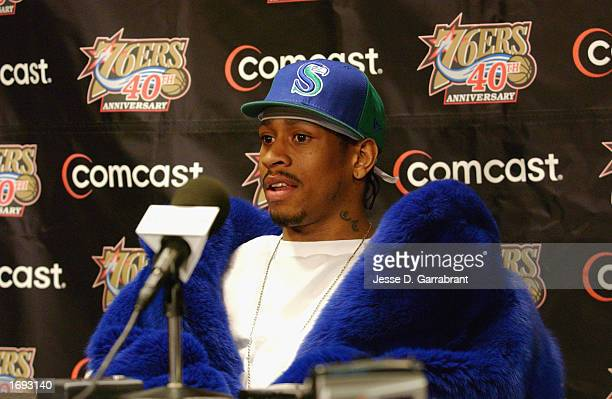 Guard Allen Iverson of the Philadelphia 76ers speaks at the post game press conference wearing a Seattle Seahawks cap after the 76ers defeated the...