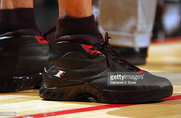 Guard Allen Iverson of the Philadelphia 76ers stands on the court and shows his right athletic shoe during the game against the Los Angeles Lakers at...