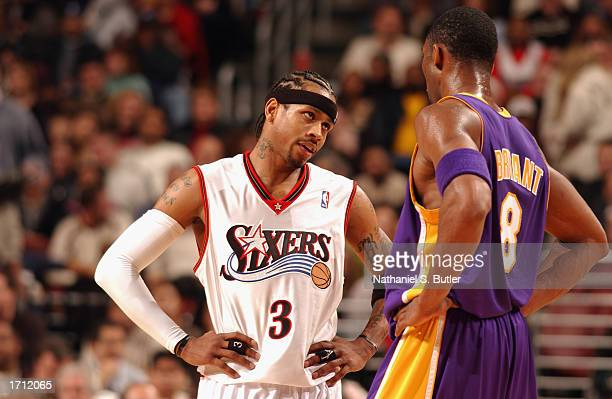 Guard Allen Iverson of the Philadelphia 76ers talks to guard Kobe Bryant of the Los Angeles Lakers during the game at First Union Center on December...