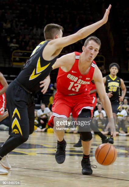 Guard Andrew Dakich of the Ohio State Buckeyes goes to the basket in the first half against guard Jordan Bohannon of the Iowa Hawkeyes on January 4...