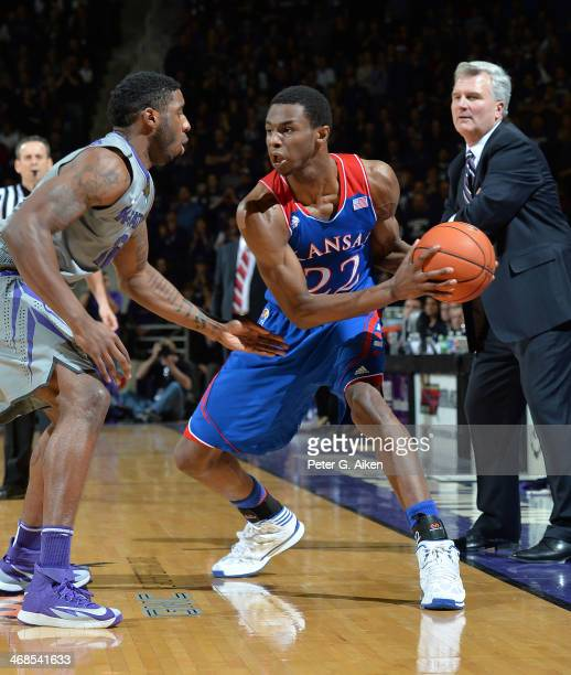 Guard Andrew Wiggins of the Kansas Jayhawks drives against guard Omari Lawrence of the Kansas State Wildcats during the first half on February 10,...