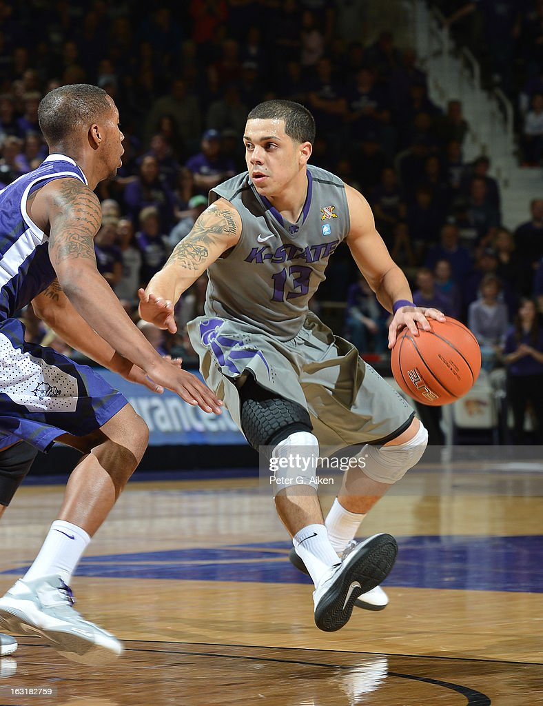 Guard Angel Rodriguez #13 of the Kansas State Wildcats drives against guard Chrles Hill #0 of the Texas Christian Horned Frogs during the second half on March 5, 2013 at Bramlage Coliseum in Manhattan, Kansas. Kansas State defeated Texas Christian 79-68.