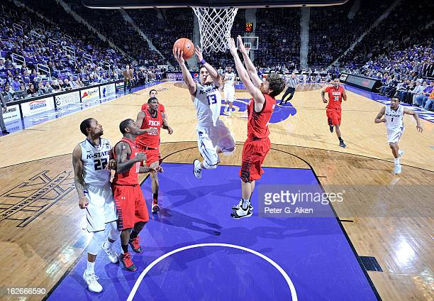Guard Angel Rodriguez of the Kansas State Wildcats drives in for a basket against guard Dusty Hannahs of the Texas Tech Red Raiders during the first...