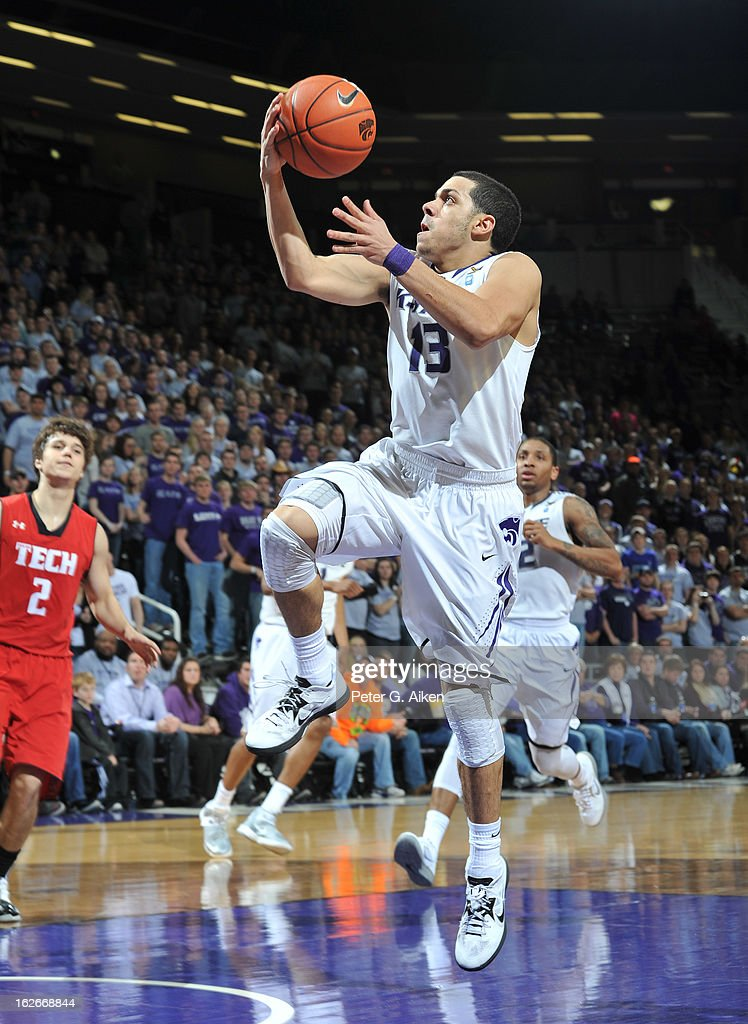 Guard Angel Rodriguez #13 of the Kansas State Wildcats drives to the basket for a score against the Texas Tech Red Raiders during the second half on February 25, 2013 at Bramlage Coliseum in Manhattan, Kansas. Kansas State defeated Texas Tech 75-55.