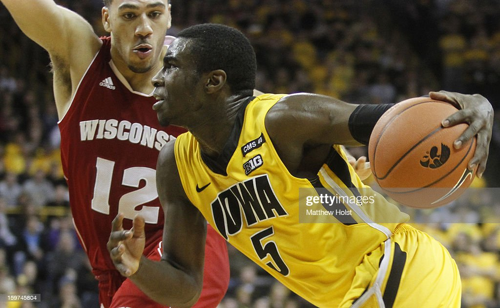 Guard Anthony Clemmons #5 of the Iowa Hawkeyes drives to the basket during the second half against guard Traevon Jackson #12 of the Wisconsin Badgers on January 19, 2013 at Carver-Hawkeye Arena in Iowa City, Iowa. Iowa won 70-66.
