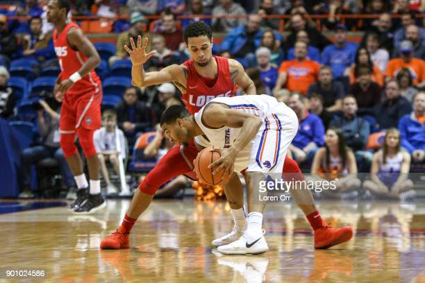 Guard Anthony Mathis of the New Mexico Lobos applies defensive pressure to guard Lexus Williams of the Boise State Broncos during second half action...