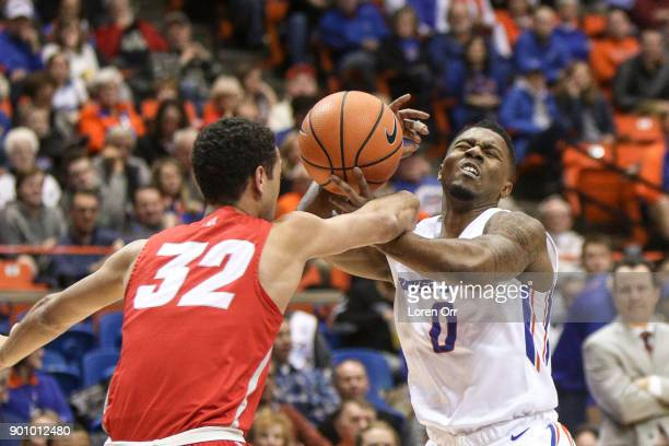 Guard Anthony Mathis of the New Mexico Lobos fouls guard Marcus Dickinson of the Boise State Broncos during first half action on January 3 2018 at...