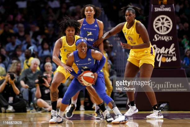 Guard Arike Ogunbowale of the Dallas Wings handles the ball in the game against the Los Angeles Sparks at Staples Center on July 18 2019 in Los...