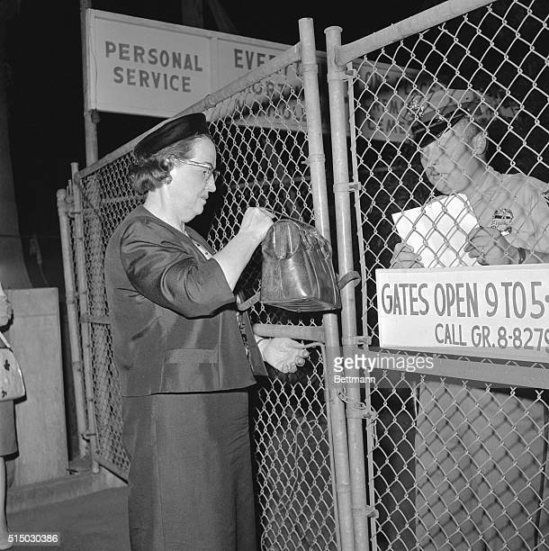 A guard at the Westwood Village Mortuary checks the name of Mrs Inez Nelson for admittance to the mortuary where the body of actress Marilyn Monroe...