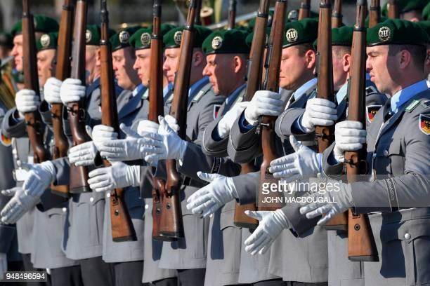 Guard Battaillon soldiers of the German Armed Forces Bundeswehr present arms for the German Defence Minister and the incoming Bundeswehr Inspector...
