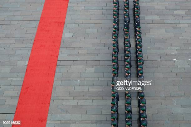 Guard Battaillon soldiers of the German armed forces Bundeswehr stand ready for a military honor guard to welcome Austria's new Chancellor at the...