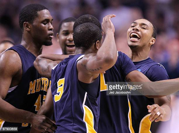 Guard BJ Jenkins of the Murray State Racers celebrates a three point basket by Isaiah Canaan against the Butler Bulldogs at the end of the first half...