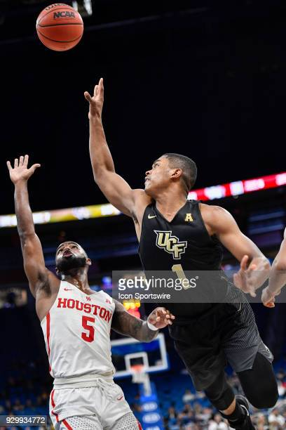 UCF guard BJ Taylor takes an off balance shot over Houston guard Corey Davis Jr during the first half of the AAC Men's Basketball Conference...