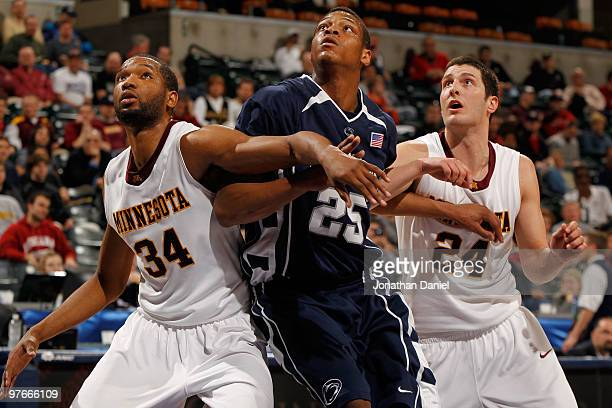 Guard Blake Hoffarber and forward Damian Johnson of the Minnesota Golden Gophers box out forward Jeff Brooks of the Penn State Nittany Lion in the...