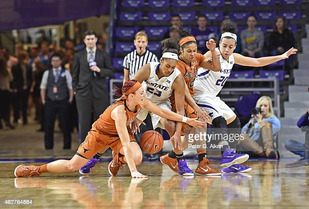 Guard Brady Sanders of the Texas Longhorns reaches for a loose ball against guard Ashia Woods of the Kansas State Wildcats during the first half on...