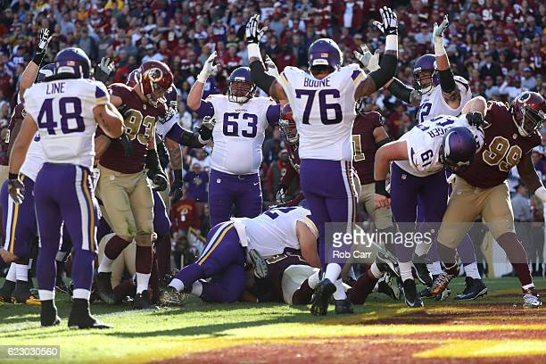Guard Brandon Fusco of the Minnesota Vikings and teammate offensive guard Alex Boone celebrate after running back Matt Asiata of the Minnesota...