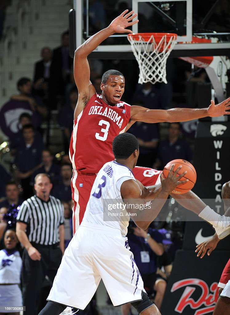 Guard Buddy Hield (top) of the Oklahoma Sooners defends guard Martavious Irving (bottom) of the Kansas State Wildcats during the first half on January 19, 2013 at Bramlage Coliseum in Manhattan, Kansas. Kansas State defeated Oklahoma 69-60.