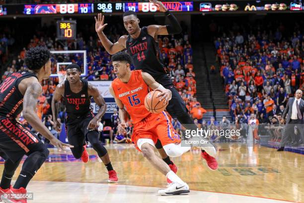 Guard Chandler Hutchison of the Boise State Broncos drives under the defense of forward Brandon McCoy of the UNLV Rebels during second half action on...