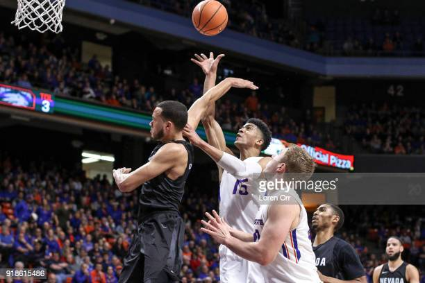 Guard Chandler Hutchison of the Boise State Broncos puts a shot up over guard Kendall Stephens of the Nevada Wolf Pack during second half action...