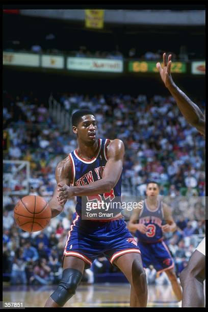 Guard Charles Smith of the New York Knicks moves the ball during a game against the Utah Jazz at the Delta Center in Salt Lake City, Utah. Mandatory...