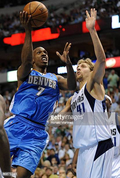 Guard Chauncey Billups of the Denver Nuggets takes a shot against Dirk Nowitzki of the Dallas Mavericks in Game Three of the Western Conference...