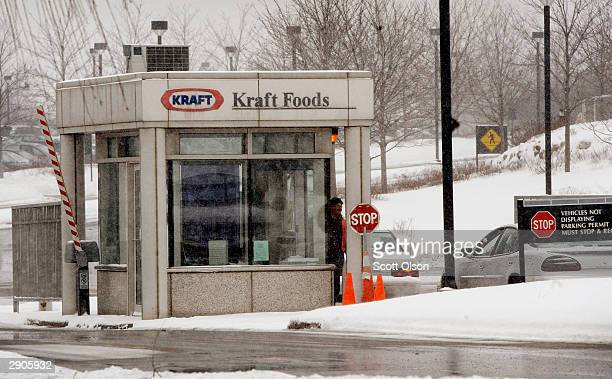 A guard checks vehicles at the entrance of the headquarters of Kraft Foods Inc January 27 2004 in Northfield Illinois Kraft is expected to announce...
