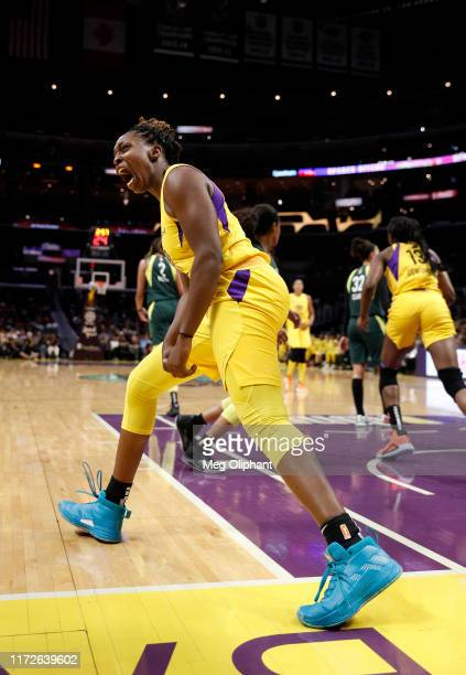 Guard Chelsea Gray of the Los Angeles Sparks celebrates a basket against the Seattle Storm at Staples Center on September 05, 2019 in Los Angeles,...