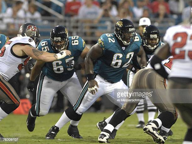 Guard Chris Naeole and center Dennis Norman of the Jacksonville Jaguars set to block against the Tampa Bay Buccaneers at Jacksonville Municipal...