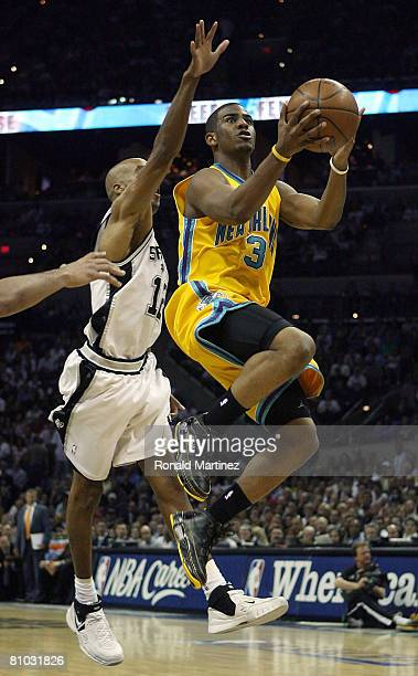 Guard Chris Paul of the New Orleans Hornets takes a shot against Bruce Bowen of the San Antonio Spurs in Game Three of the Western Conference...