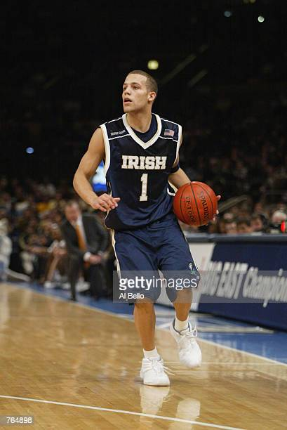 Guard Chris Thomas of the Notre Dame Fighting Irish brings the ball down the wing against the Connecticut Huskies during the Big East Conference...