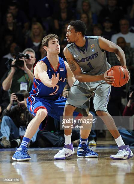 Guard Conner Teahan of the Kansas Jayhawks defends against guard Shane Southwell of the Kansas State Wildcats during the first half on February 13...