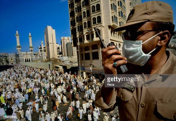 A guard controls the flow of pilgrims around the Masjid AlHaram mosque during the hajj on March 2000 in Mecca Saudi Arabia Over five days of Hajj...
