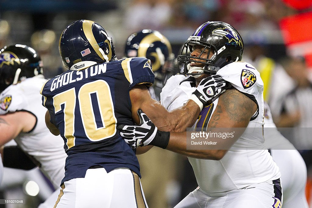 Guard Cord Howard #67 of the Baltimore Ravens tries to hold off linebacker Vernon Gholston #70 of the St. Louis Rams during the game against the St. Louis Rams at the Edward Jones Dome on August 30, 2012 in St. Louis, Missouri. The St. Louis Rams defeated the Baltimore Ravens 31-17.