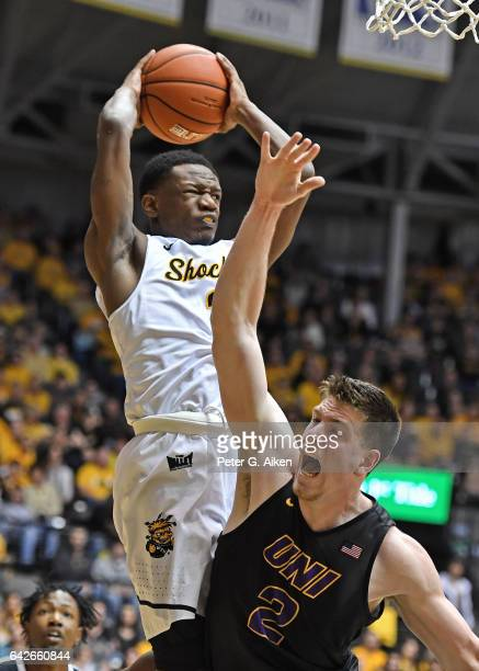 Guard Daishon Smith of the Wichita State Shockers grabs a rebound over forward Klint Carlson of the Northern Iowa Panthers during the second half on...